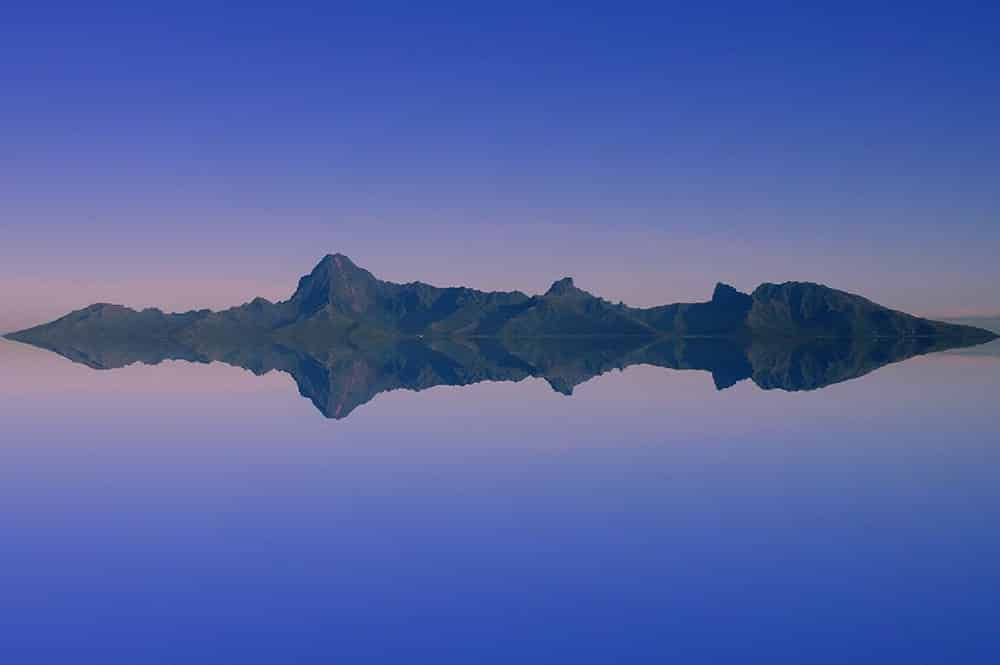 Rising sun over Moorea. Photo Pierre Lesage